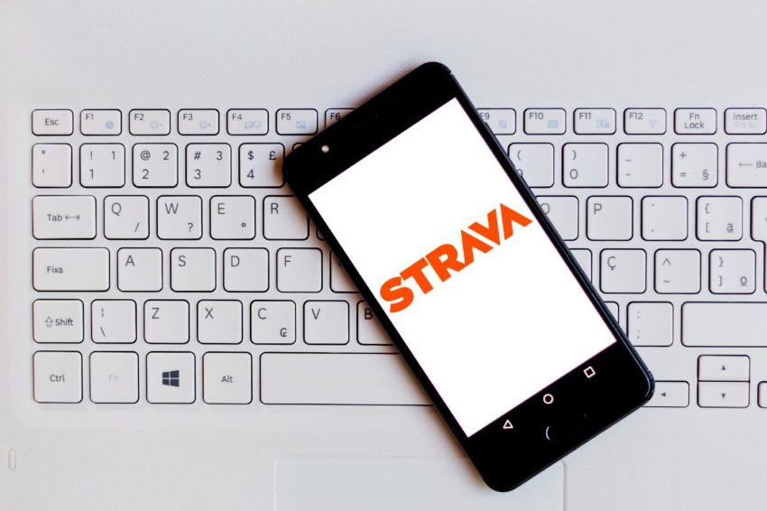 Strava logo on an iphone on top of a keyboard