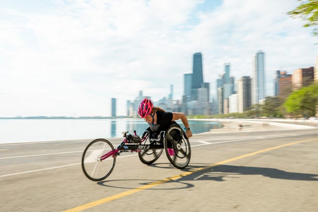para-athlete Mary Kate Callahan flying along Chicago's Lakefront trail in her wheelchair